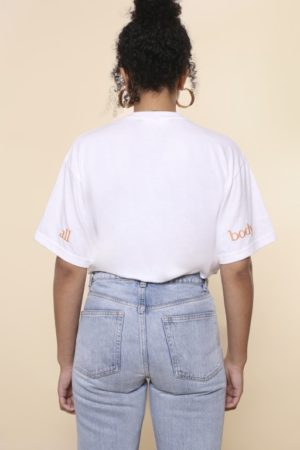 Girl wearing white slogan t-shirt (rear)