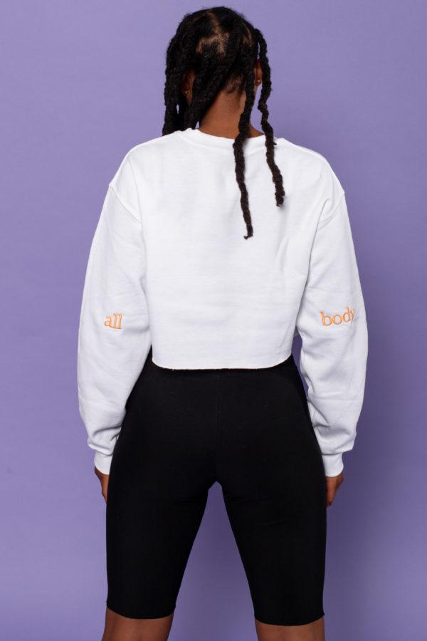 Girl wearing white cropped sweatshirt
