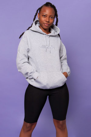 Girl wearing grey hoodie