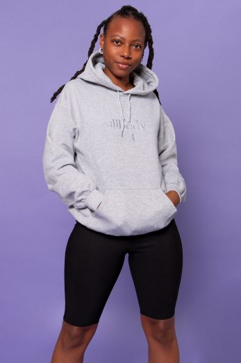 Girl wearing grey hoodie