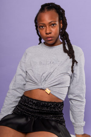 girl wearing grey cropped longsleeve