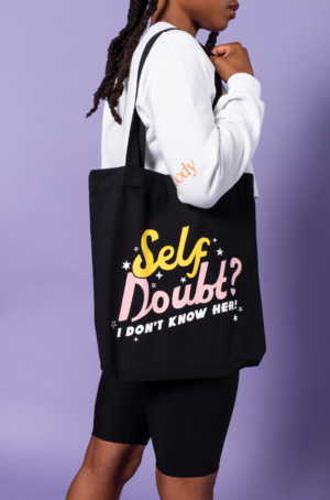 Girl wearing Self Doubt Tote Bag